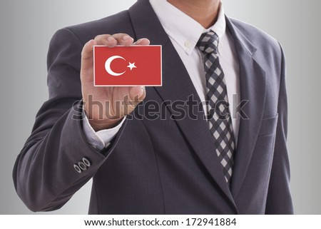 Businessman holding a business card with Turkey Flag  - stock photo