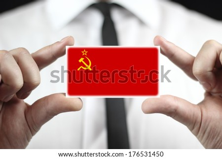 Businessman holding a business card with USSR Flag - stock photo