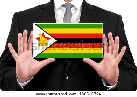 Businessman holding a business card with Zimbabwe Flag - stock photo