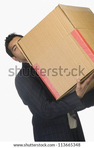 Businessman holding a cardboard box - stock photo