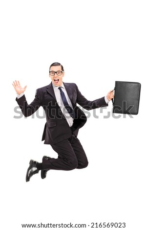 Businessman holding a case and jumping in the air isolated on white background