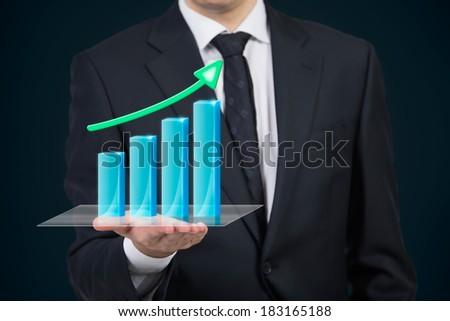 Businessman holding a chart - stock photo