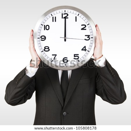 Businessman Holding a Clock
