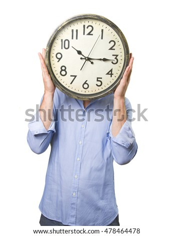 Businessman holding a clock on white background