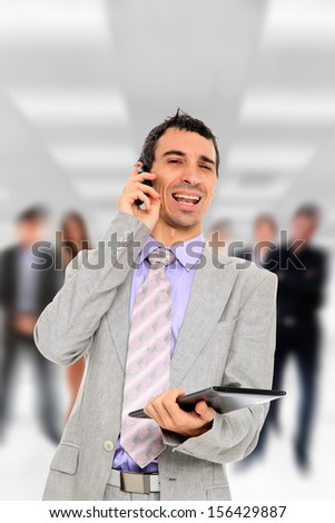 Businessman holding a computer tablet in front of his Business team in the office