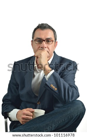 Businessman holding a cup of tea sitting in a chair. isolated on white background - stock photo