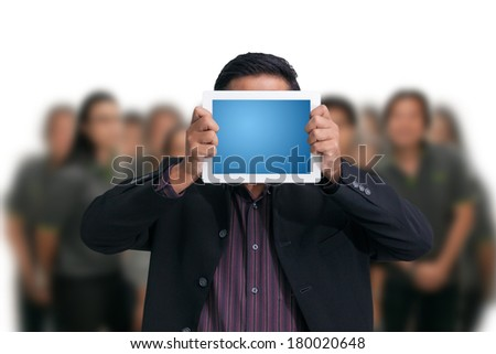 Businessman holding a digital tablet - stock photo
