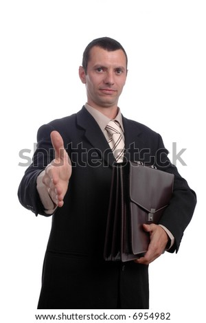 Businessman holding a document wallet welcoming you with a handshake.