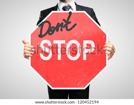 businessman holding a dont stop sign - stock photo