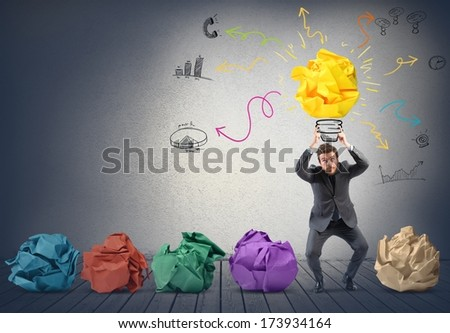 Businessman holding a drawing of new creative idea - stock photo