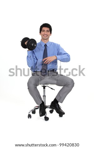 businessman holding a dumbbell - stock photo