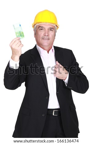 Businessman holding a 100 euro note - stock photo
