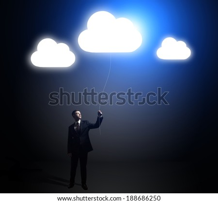 businessman holding a flying cloud. idea concept