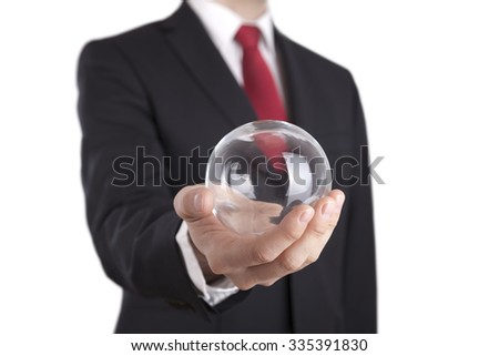 Businessman holding a glass ball isolated on white. Clipping path included. - stock photo
