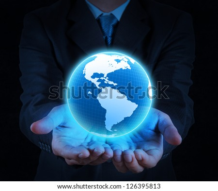 businessman holding a glowing earth globe in his hands
