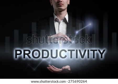 Businessman holding a glowing text productivity. business concept. - stock photo