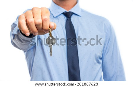 Businessman holding a key against white background - stock photo