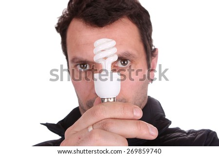 businessman holding a lamp - stock photo
