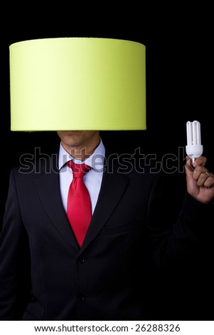 businessman holding a lamp (it's not his idea)