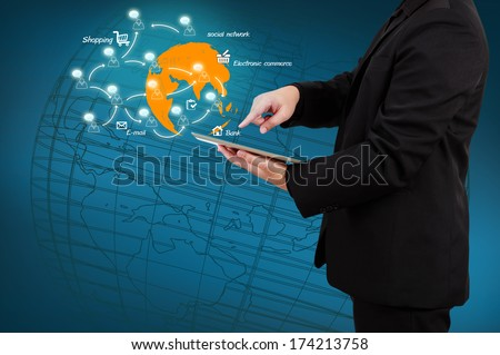 Businessman holding a laptop with globe and icon application on virtual screen. E-business concept. - stock photo