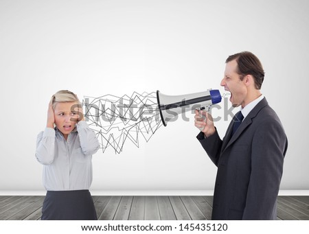 Businessman holding a megaphone and screaming at his colleague - stock photo