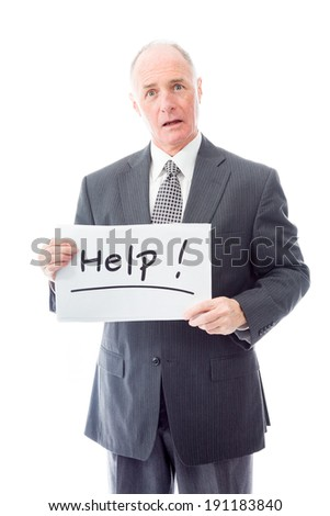 "Businessman holding a message board with the text words ""Help"" - stock photo"