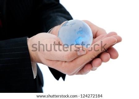 businessman holding a mini globe, shallow - stock photo