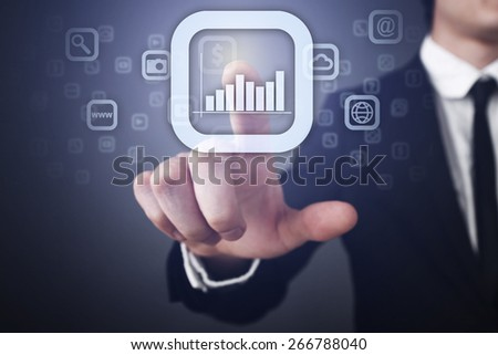 Businessman holding a mobile phone with app icon on virtual screen. Internet concept. Business concept. - stock photo