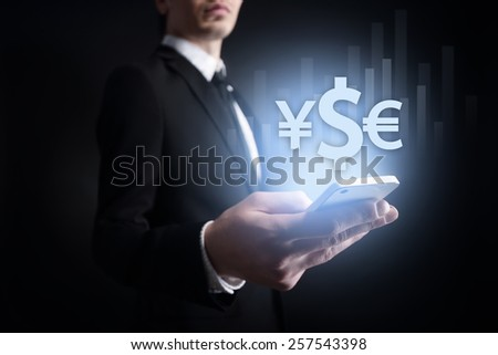 businessman holding a mobile phone with currency icon. stock trading, investment. internet banking. business concept. - stock photo