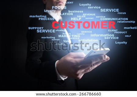 Businessman holding a mobile phone with customer text on virtual screen. Internet concept. Business concept. - stock photo
