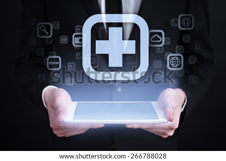 Businessman holding a mobile phone with medical app icon on virtual screen. Internet concept. medical concept. - stock photo