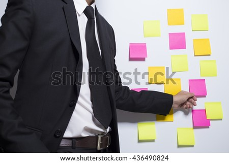 Businessman holding a notepaper
