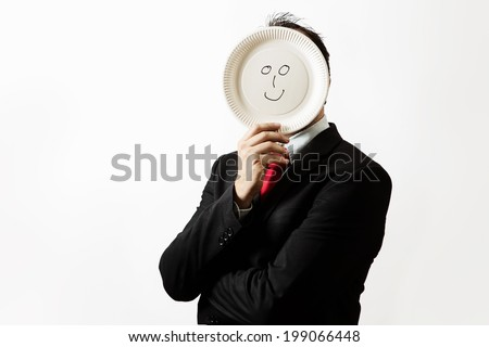 businessman holding a paper plate up to his face with a happy face draw on plate