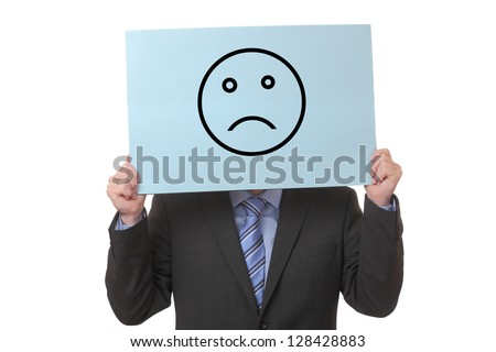 Businessman holding a paper with a negative smiley on white background