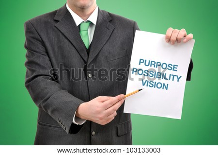 Businessman holding a paper with printed marketing terminology.