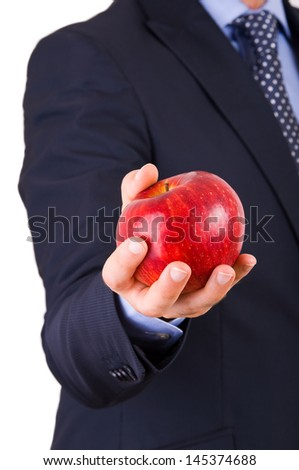 Businessman holding a red apple. - stock photo