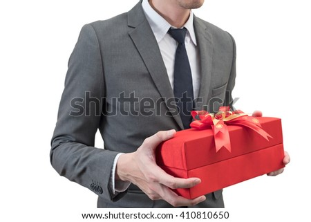 Businessman holding a red giftbox  isolated on white background.