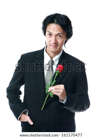 Businessman holding a rose,attractive 40 years old asion man on white background