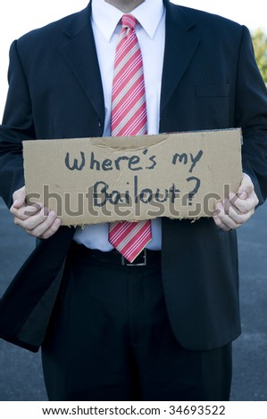 "Businessman holding a sign that says ""where's my bailout?"" - stock photo"