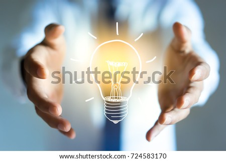 Businessman holding a sketch lightbulb