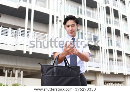 Businessman holding a smart phone