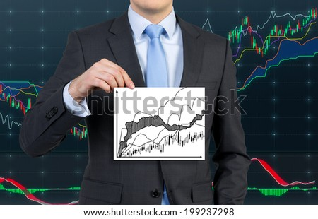 Businessman holding a stock exchange placard, forex background. - stock photo