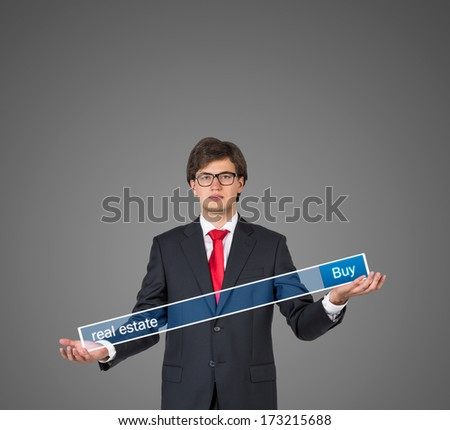 Businessman holding a table 6 - stock photo