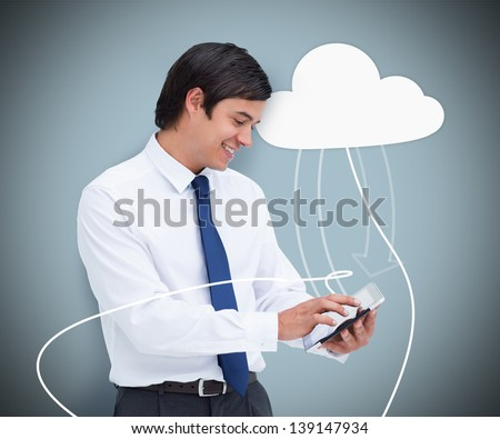 Businessman holding a tablet computer connected to cloud computing symbol on blue background - stock photo