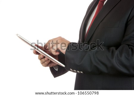 Businessman holding a tablet computer in his hands - stock photo