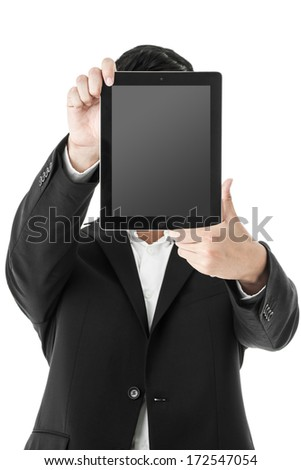 Businessman holding a tablet in front of his face - stock photo