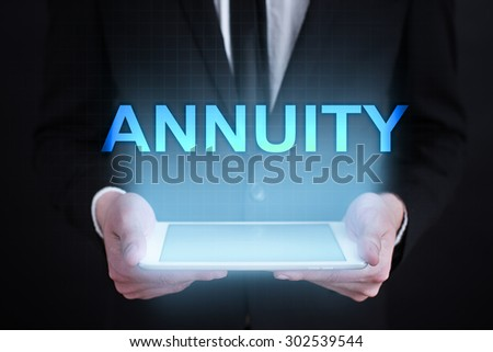 "Businessman holding a tablet pc with ""Annuity"" text on virtual screen. Business concept. Internet concept."