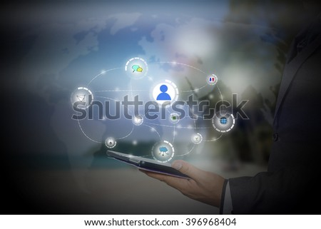 businessman holding a tablet PC with contact on virtual screens - business, technology, internet and social networking concept