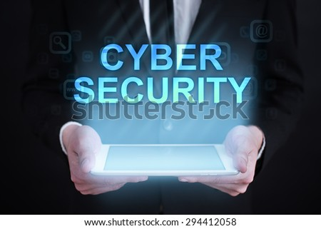 """Businessman holding a tablet pc with """"Cyber security"""" text on virtual screen. Internet concept. Business concept. - stock photo"""