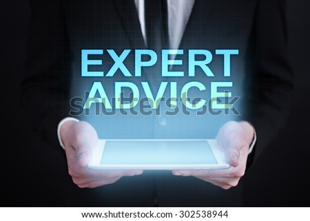 "Businessman holding a tablet pc with ""expert advice"" text on virtual screen. Business concept. Internet concept. - stock photo"